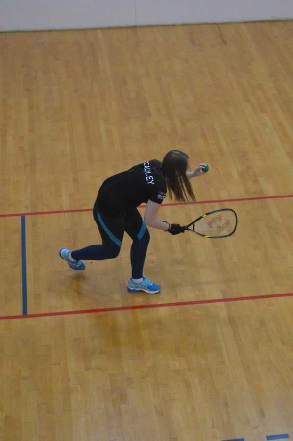 Junior Megan McCauly serves a ball in the National racquetball tournament in Feb. 2019.