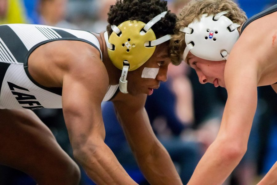 On Feb. 1, senior Jalin Reese works to gain position on his opponent. He finished second in the tournament, helping the team place fourth.