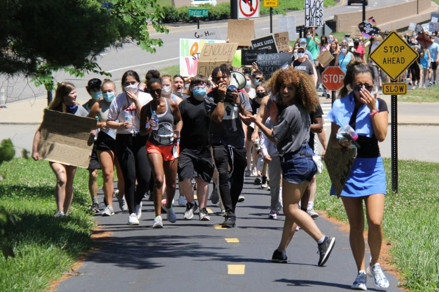 Class of 2020 graduates Cassandra Limon and Malayka Walton lead participants as City of Wildwood Police blocked off intersections on the road. The crowd marched across streets through the path that hugs Highway 109.