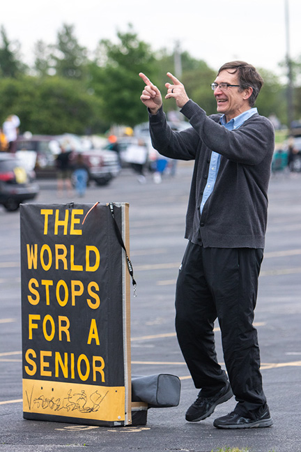 Retiree, Paul Krull, congratulating the class of 2020 at their graduation ceremony.