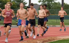 Juniors Sam Aven and Nikolas Malek run in a boys varsity cross country practice. Cross country for both boys and girls, along with boys swimming, girls golf and girls tennis, was recently cleared by St. Louis County to resume play.