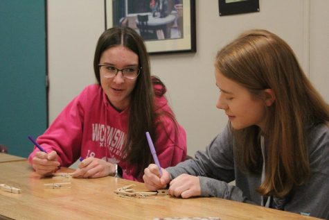 In November 2019, Lancers Helping Lancers organized and executed a mental health week. Seniors Sydney Stinnett and Taylor Wulf help to make clothespins to clip on to unsuspecting student's clothes and backpacks with uplifting messages written on them.