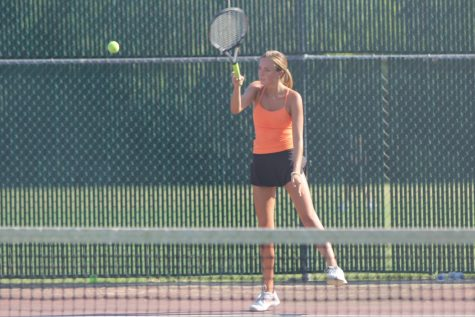 Senior Claire Goedeke returns the tennis ball to her opponent