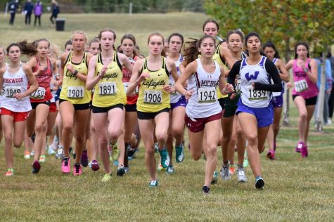 At the Parkway West Dale Shepard Invitational on Oct. 3 at Living Word Church in Wildwood, sophomores Elissa Barnard and Grace Tyson, and seniors Katie Reed and Hope Ware make their way to the front of the pack at the start of the race. The Lady Lancers placed first n the event as a team.