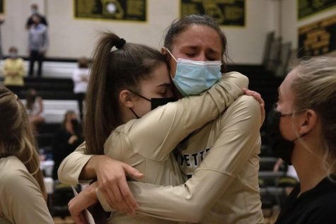 At the end of her final home game for the Lancers, senior Morgan Isenberg hugs a teammate. The Lancers beat Seckman in four sets.