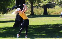 In a match, senior Brooke Biermann drives the golf ball up the course. Biermann placed second at the Missouri State High School Activities Association (MSHSAA) State tournament, shooting three under par in inclement conditions. Biermann's score, along with others, helped boost Lafayette to fifth place overall in the tournament.