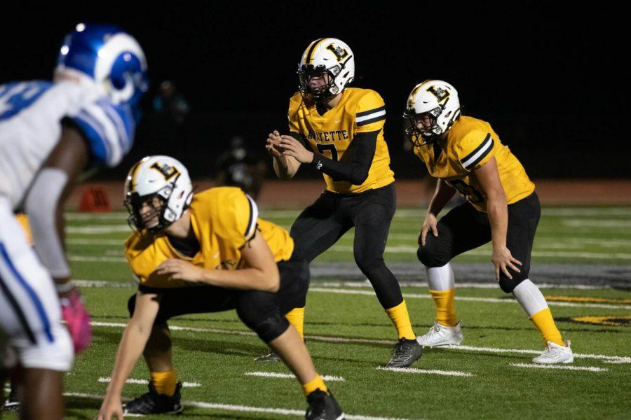 Senior quarterback Blake Micek gets ready to receive the snap.
