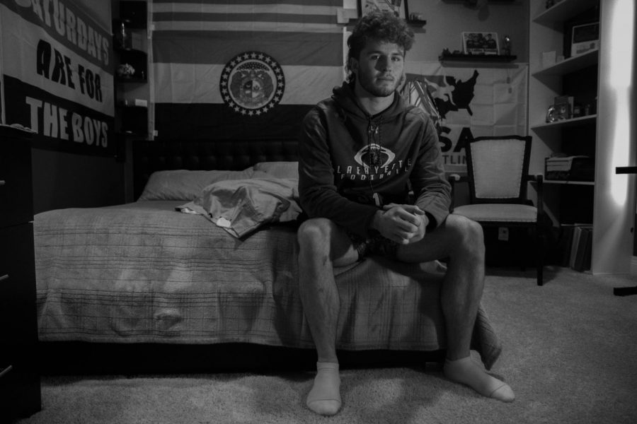 Tommy Hagan sits in his isolation room, where he stayed after testing positive for coronavirus. For meals he said,