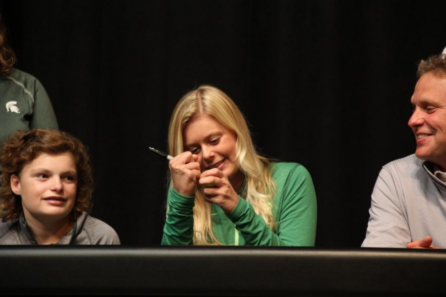 Senior Brooke Biermann signs a gold ball after signing her letter of intent for Michigan State University for girls golf. Over her Lafayette career, Biermann has medaled at State four times. In her freshman year she placed fourth, in her sophomore year she placed second, in her junior year she placed first and this year, she placed second.