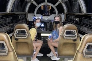 My sister and I driving the Star Wars: Millennium Falcon-Smugglers Run.