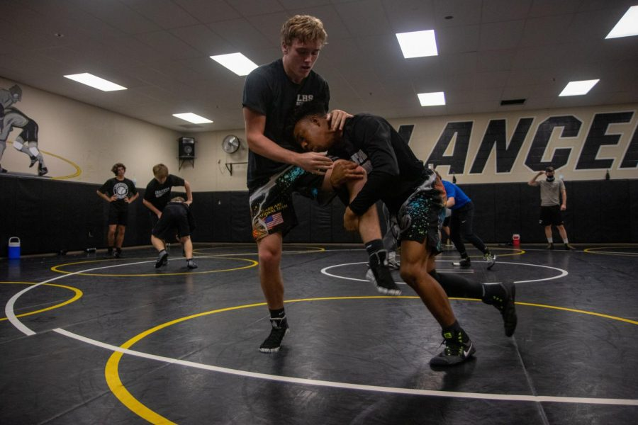 During practice, senior Na'zir Dent takes down junior Max Doehring. Dent took down Doehring in a challenge match for a spot on the varsity lineup. Dent will compete in the 152 pound weight class in the first duel of the season at Timberland on Dec. 1.