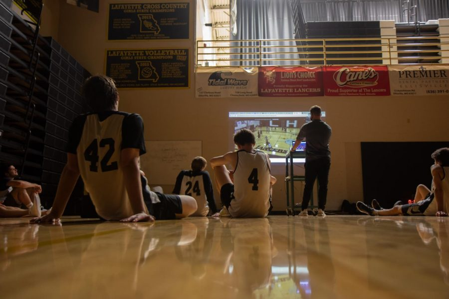 During a boys basketball practice, the team watches film in the Main Gym. All winter teams are required to wear masks while practicing and playing due to new St. Louis County regulations for youth sports.