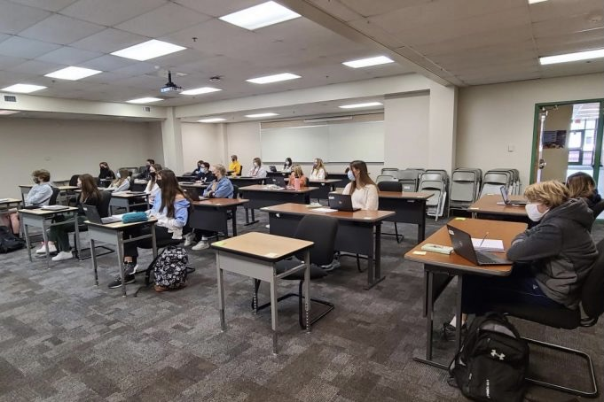 Jeffery Landow teaches his 6th hour Language arts class in a larger room than usual to accomodate for him being immunocompromised.