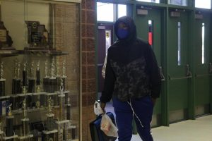 Sophomore Jeremy Lewis enters the school for the first day of return to in-person learning on  Nov. 12. Lewis is a member of the VICC program and every school day makes the journey from St. Louis City to attend Lafayette High School.