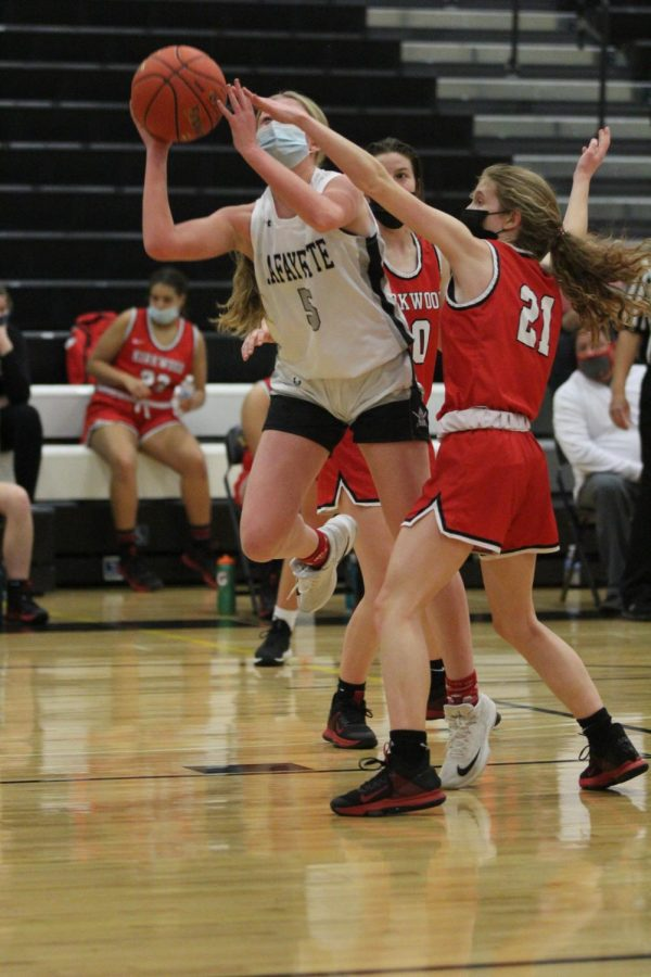 Senior Brynn Jeffries shoots for two during the first quarter. The Pioneers got off to a quick start, scoring 7 points in the first couple of minutes, but the Lancers rallied back to lead by the end of the quarter.