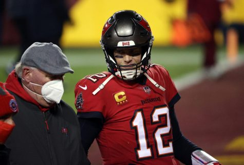 Tampa Bay Buccaneers quarterback Tom Brady (12) walks off the field alongside head coach Bruce Arians after a 31-23 victory against the Washington Football Team in the NFC Wild Card Playoffs at FedExField in Landover, Maryland, on Saturday, Jan. 9, 2021.