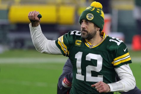 Aaron Rodgers #12 of the Green Bay Packers leaves the field following the NFC Divisional Playoff game against the Los Angeles Rams at Lambeau Field on Jan. 16, 2021 in Green Bay, Wisconsin. The Packers defeated the Rams 32-18.