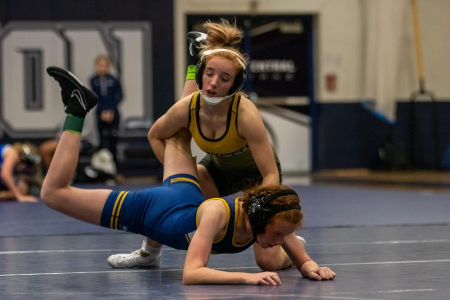 Junior Faith Cole takes down her opponent at the Wenztville Holt Quad earlier in the season. Cole helped lead the team to a second place plaque at the Kansas City Duals on Jan. 15.