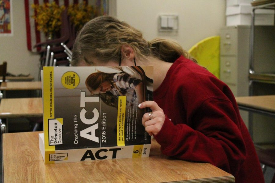A student prepares for an upcoming ACT despite many colleges going test-optional on their admissions requirements for next year. However, strong test scores can still help students improve their chances of acceptance to some schools and also help in earning valuable scholarship money.