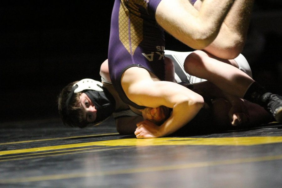 Senior Ben Thomas battles against his Eureka High School opponent during a meet on Jan. 6.
