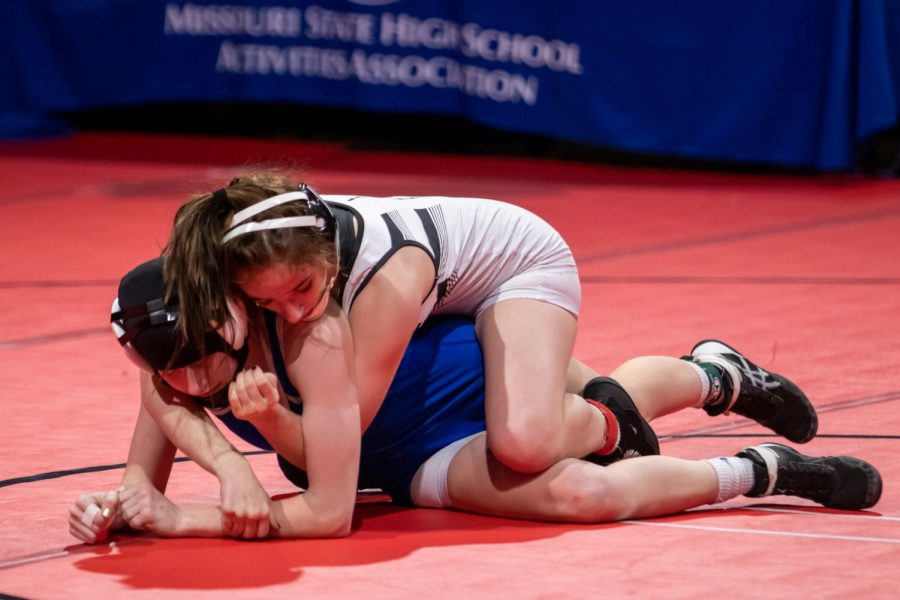 In+the+State+finals%2C+junior+Faith+Cole+holds+her+opponent+down.+After+this+final+match+Cole+won+her+third+straight+State+title.+