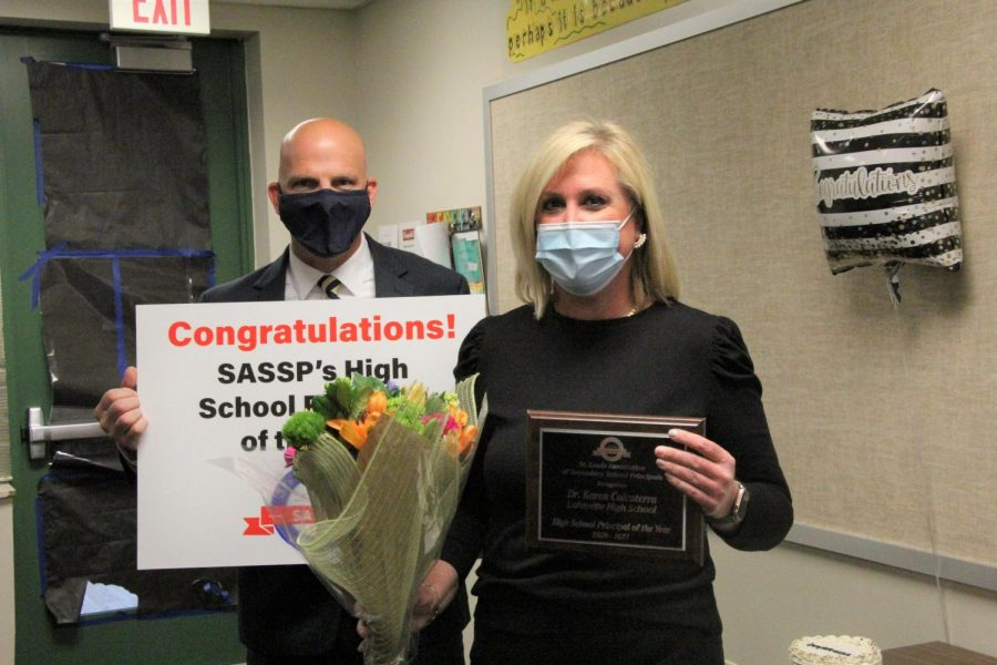 Principal Karen Calcaterra along with SASSP board member Gary Jansen after being surprised with the 2020-2021 Principal of the Year award.