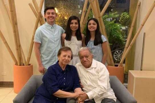 Kate Vera and her siblings pose with their grandparents while visiting them before the pandemic.