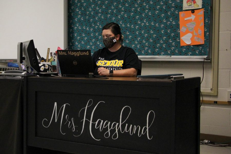 FACS teacher Erin Hagglund works at her desk during a plan period. At the beginning of the school year, Hagglund decided that her classroom decor could use a refresh. While her vision for the room is not complete, Hagglund is happy with the progress made and enjoys allowing her students to help her.