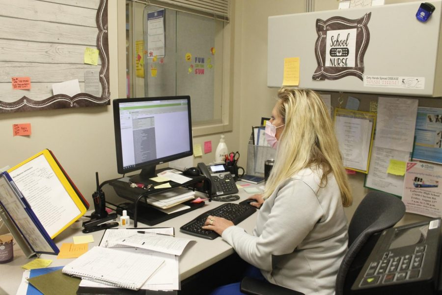 Lafayette school nurse Kristen Emms checks Infinite Campus in her office during 4th Hour on May 4. Emms has been one of Lafayette's nurses for two years.
