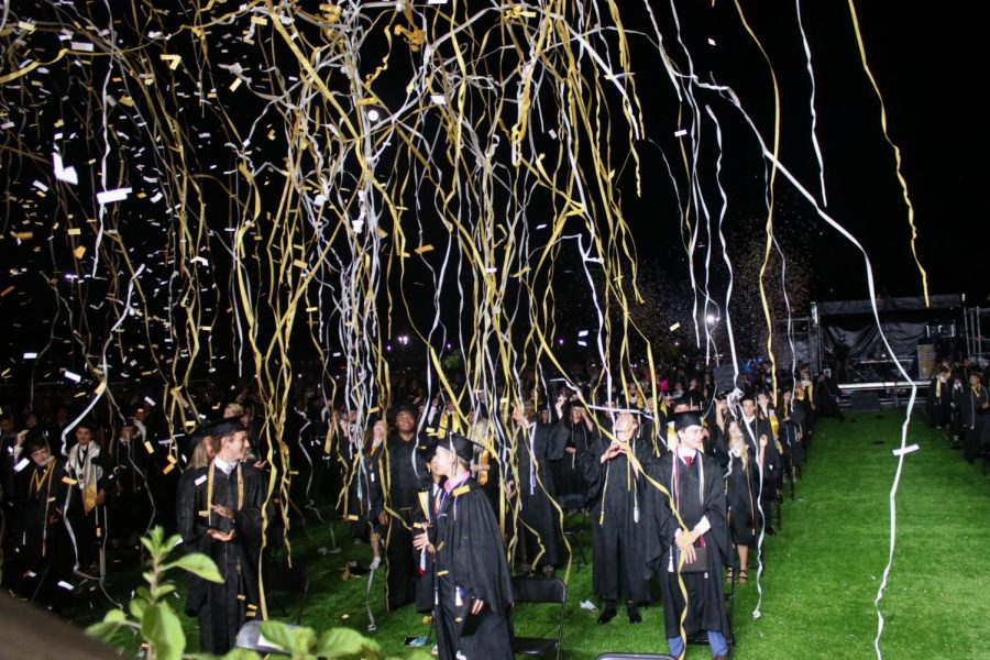 The class of 2020 celebrates with streamers after their graduation ceremony commences. Last year's graduation was held at the same venue as this year's, the Power Plex, and similarly had people watch from their cars. In years past, the graduation ceremonies have taken place on the football field, with spectators watching from the bleachers, but the new format was devised in the midst of the COVID-19 pandemic.