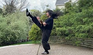 Senior Navya Nagpal practices martial arts on her patio to keep her skills sharp.
