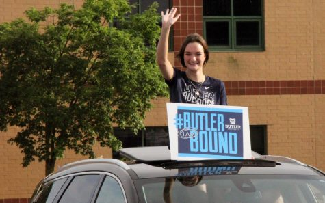 With her sign proudly announcing her college choice, senior Rachel Brown waves at Lafayette staff members in the parking lot during the Senior Salute Parade on May 24. Though not part of the official Senior Week events, the parade of seniors was another special event for the Class of 2021.
