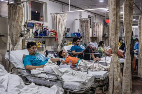 Patients who contracted the coronavirus lie in beds while connected to oxygen supplies inside the emergency ward of a Covid-19 hospital on May 03, 2021, in New Delhi, India. India recorded more than 360,000 coronavirus cases in one day for the 12th day in a row as the total number of those infected according to Health Ministry data neared 20 million.