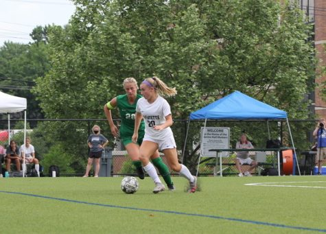 Rising senior Rylee Howard takes the ball down field as a Nerinx Hall player defends from behind during the Class 4 girls soccer Sectional game on May 25 at Nerinx Hall High School. The Lancers fell 0-1 on a corner kick with just over five minutes left in regulation.