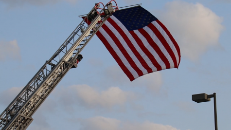 The Metro West Fire Department displays American flag at the Patriot Day at Lafayette on Sept. 10. Members of the ROTC helped organize the event for the rest of the Lafayette community.