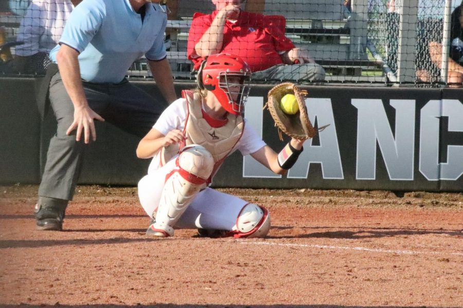 During the fourth inning of the game against Francis Howell on Sept. 1, sophomore catcher Lilian Ware grabs a pitch behind the plate. The Lancers won, 3-0  bringing their season record to 3-4.