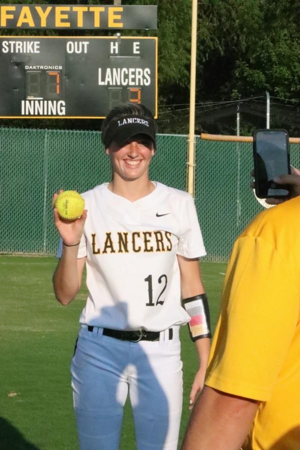 Carr poses as Holtmann takes a photo to post on Twitter to celebrate her game. Carr pitched for the Lancers in their first home game of the season and she achieved a no-hitter game. A no-hitter game is when a pitcher doesnt allow the opposing team to run any bases on a hit, limiting them to walks.
