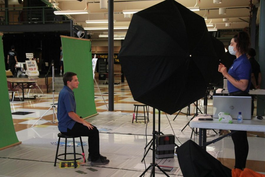 A student has his school photo taken before the start of the 2020-2021 school year. This years make-up photos are scheduled for Sept. 9 during AcLab. Any 9th, 10th or 11th grader who has not had a photo taken should check with their teacher at the beginning of homeroom to find out their appointment time.