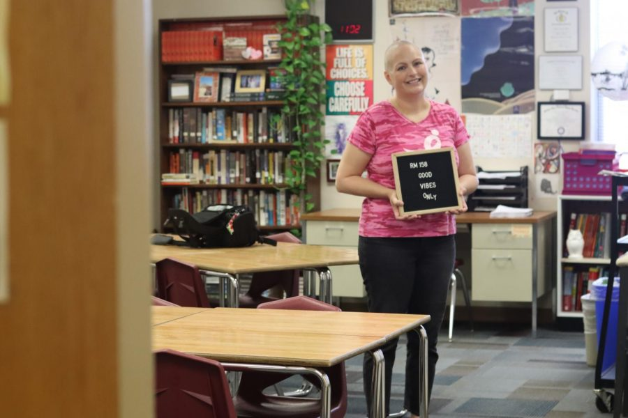 Language arts teacher Jenny Ingram stands in her classroom holding her Good Vibes Only sign. Ingram places emphasis on creating a positive environment in her classes. In June 2021, Ingram learned that her Breast Cancer resurfaced as Stage Four. For me, [a stage four diagnosis] is like a chronic illness, its not a death sentence. Ive read that stage four breast cancer can wax and wane. I may get to a point where theres no evidence of disease, the medication Im taking is effective and you dont see lesions in the bones or tumors, it could get to that. But youre never cured. You always have to be monitoring it, she said. October is also Breast Cancer Awareness Month.