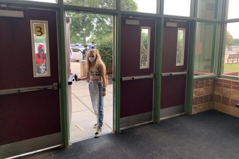 Sophomore Melissa Pinkstaff walks into school on Friday, Sept. 3, wearing a crop top as part of a staged protest.