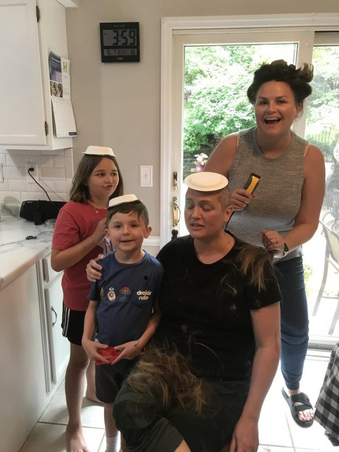 Language+arts+teacher+Jenny+Ingram+shaves+her+head+after+her+diagnosis+with+her+sister%2C+Jessica+Prosperi%2C+and+her+niece+and+nephew%2C+Amelia+and+Jonathan.