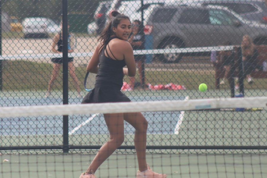 At Districts for girls tennis, senior Thrisha Kosaraju volleys back the ball to her opponents. Kosaraju and her opponent junior Saanvi Gudreddi won in their doubles match and are now headed to the State Tournament in Springfield, Missouri.