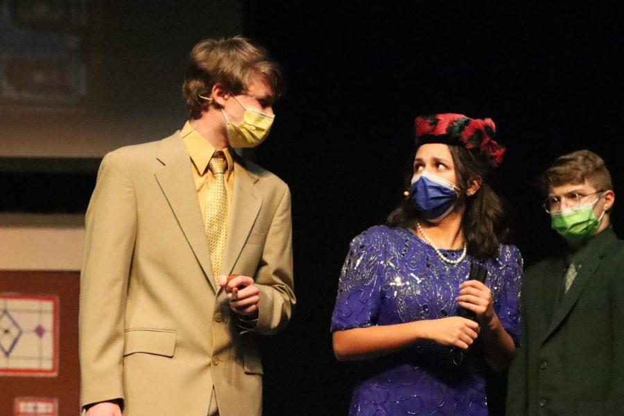 Sophomore Ben Dimmic, who played Colonel Mustard, and Flores character, Mrs. Peacock, face off after Mustard suggests that they split up to search the house and find the murderer.