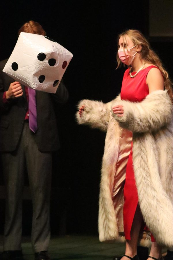 Junior Makenzie Elsalaymehs character, Miss Scarlett, rolls a die to determine her pair for splitting up to search the house. After not getting the rolls they desired, the characters moved the die upstage to go unseen by the audience.