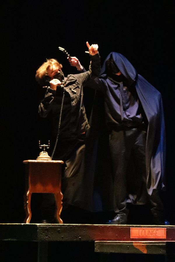Senior Jake Bingham, who played the Hooded Figure, murders one of junior Logan Jaycoxs characters, The Motorist, with a wrench just before he can reveal one of the characters true identity. Both Bingham and Jaycox played multiple characters throughout the duration of the play, Bingham played both Mr. Boddy and The Hooded Figure, while Jaycox played the parts of The Motorist and The Cook.