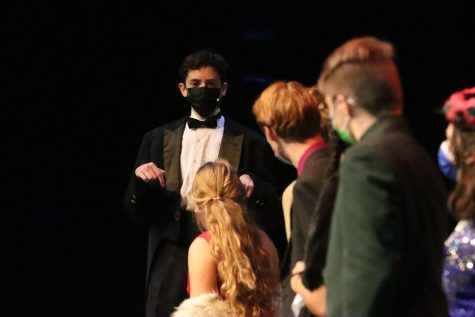 Wadsworth, the butler, played by junior Micah Bounds, explains to the rest of the characters how he believed the evenings events resulted in mutliple murders. His first accusation was that the character Mrs. Peacock had committed the murders.