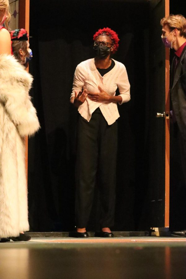 One of senior Erica Sheltons characters, the Evangelist, makes a stop to talk to the characters about her religion in the midst of multiple murders in the play. Shelton played three different characters througout the course of the play, including The Cop, The Singing Telegram Girl and the Evangelist.
