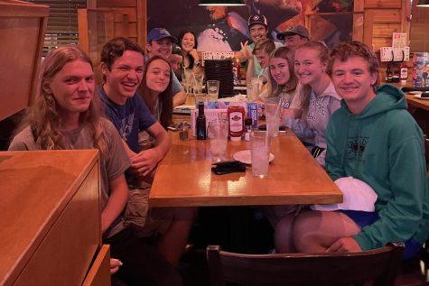 Seniors eat at Texas Roadhouse on Oct. 3. The group includes seniors Grace Boschert, Nick Boschert, Bennet Bradley, Madi Burgard, Devan Ellison, Anderson Guvvy,  Austin Hammann, Oscar Labit, Corban Leslie, Duron McVean, Blake Ryle and Naomi Wipfler.