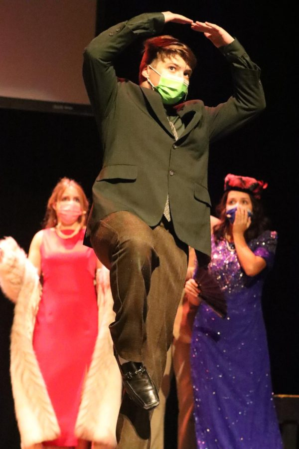 After revealing his identity and role in the events of the evening, Josh Lanzottis character, Mr. Green, poses as a plant, to show the other characters that he remained unsuspected all along.