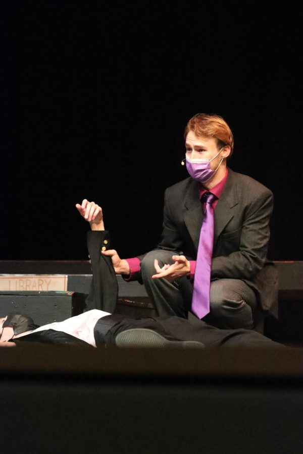 After Bounds character, Wadsworth, was killed by Lanzottis character, Mr. Green, Schapers character, Professor Plum checks to ensure his death was final.